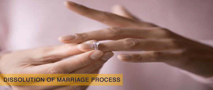 Woman removing wedding ring from her finger